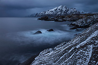 Dark sky over coast at noon during December Mørketid - Polar night, Nesland, Lofoten Islands, Norway