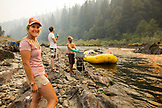 USA, Oregon, Wild and Scenic Rogue River in the Medford District, River Guide Taylor Buchannon stands by the Rogue