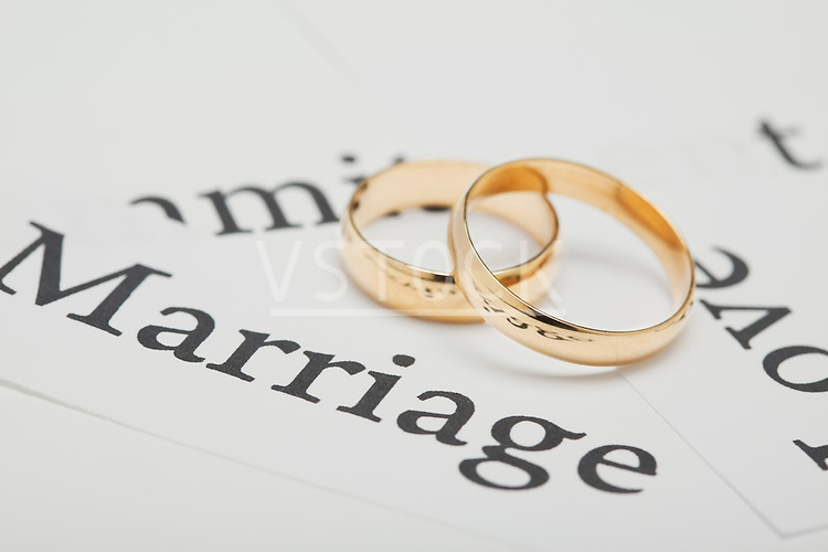 USA, Illinois, Metamora, Two wedding rings on paper with words connected with wedding