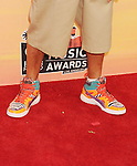 LOS ANGELES, CA- MAY 01: Rapper/producer Lil Jon (shoe detail) at the 2014 iHeartRadio Music Awards held at The Shrine Auditorium on May 1, 2014 in Los Angeles, California.