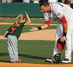 July 9, 2009: A young ballplayer slaps hands with third baseman Will Middlebrooks (11) of the Greenville Drive before a game at Fluor Field at the West End in Greenville, S.C. Photo by: Tom Priddy/Four Seam Images