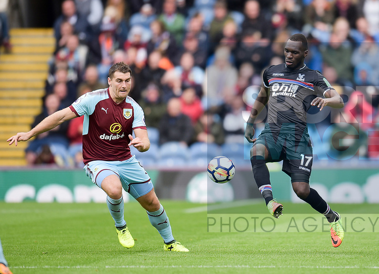 Crystal Palace's Christian Benteke and Burnley's Sam Vokes in action during the premier league match at the Turf Moor Stadium, Burnley. Picture date 10th September 2017. Picture credit should read: Paul Burrows/Sportimage