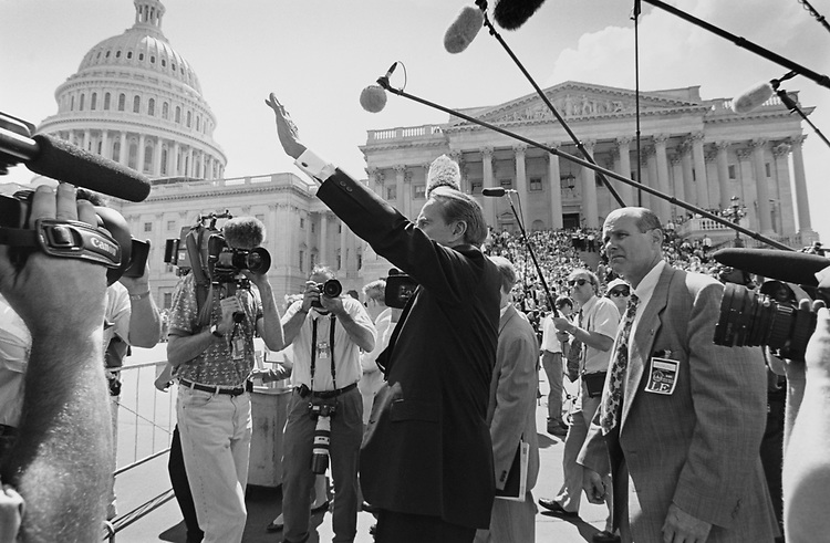 Sen. Bob Dole, R-Kans., waves goodbye to the crowd on his last day in the Senate on Capitol Hill in June 1996. (Photo by Laura Patterson/CQ Roll Call via Getty Images)