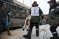Musher Lachlan Clark, of Buena Vista, Colo., puts dogs in harnesses at the ceremonial start of the 43rd Iditarod dog sled race in downtown Anchorage. 79 mushers made their way 11 miles through the slushy streets of Anchorage in unseasonably warm weather and early rain. This year's official re-start will begin in Fairbanks because of poor trail conditions in Southcentral Alaska.