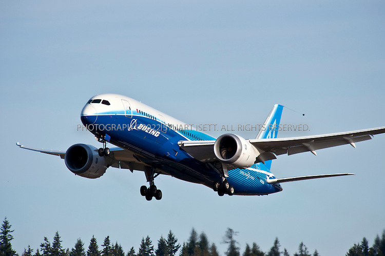3/20/2011--Everett, WA, USA..A Boeing 787 Dreamliner runs test flights at Paine Field just north of Seattle...The Boeing 787 Dreamliner is a mid-sized, wide body, twin engined jet airliner currently under development by Boeing .It will carry between 210 and 330 passengers depending on the seating configuration. Boeing has stated that it will be more fuel-efficient than comparable earlier Boeing airliners. It will also be the first major airliner to use composite material for most of its construction. Boeing claims that the 787 will be up to 20% more fuel-efficient than current comparable aircraft. ..50% of the aircraft's weight are from the composite materials shown here. Composite materials are significantly lighter and stronger than traditional aircraft materials, making the 787 a very light aircraft for its capabilities. By volume, the 787 will be 80% composite. This will allow the potential to take off from, and land on, relatively short airstrips as the 767 can, yet still have the capability to fly long-haul distances....©2011 Stuart Isett. All rights reserved
