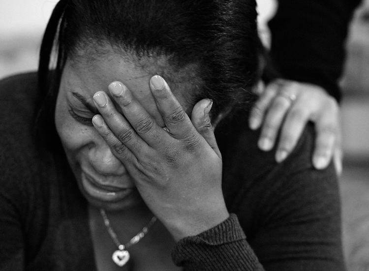 Lecrecia Rivera is comforted by a family member as she mourns the loss of her grandson, 2-year-old Daylan Walker in Boston on Wednesday, May 28, 2014. The toddler was found dead outside a Columbia Road apartment complex earlier in the day. Photo by Christopher Evans.