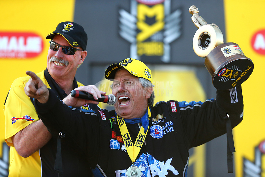 Mar 19, 2017; Gainesville , FL, USA; NHRA funny car driver John Force is interviewed by announcer Alan Reinhart as he celebrates after winning the Gatornationals at Gainesville Raceway. Mandatory Credit: Mark J. Rebilas-USA TODAY Sports