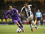 Isco of Real Madrid in action with Alex Sandro of Juventus during the Champions League Final match at the Millennium Stadium, Cardiff. Picture date: June 3rd, 2017.Picture credit should read: David Klein/Sportimage