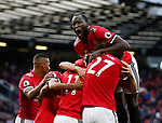 Romelu Lukaku of Manchester United jumps to celebrate the fourth goal by Anthony Martial of Manchester United during the premier league match at the Old Trafford Stadium, Manchester. Picture date 17th September 2017. Picture credit should read: Simon Bellis/Sportimage