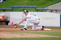 West Michigan Whitecaps first baseman Blaise Salter (24) receives a throw during a game against the Clinton LumberKings on May 3, 2017 at Fifth Third Ballpark in Comstock Park, Michigan.  West Michigan defeated Clinton 3-2.  (Mike Janes/Four Seam Images)