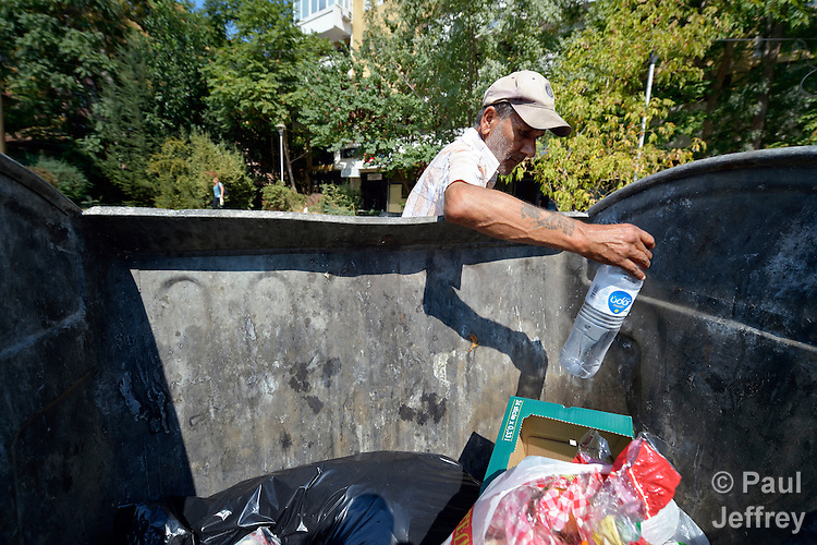 Sadedin Husein, 63, is a Roma man who lives in the mostly Roma town of Suto Orizari, Macedonia, but spends his days at work collecting plastic bottles in the streets of Skopje, which he sells to recyclers.  Here he is pulling bottles out of garbage dumpsters.