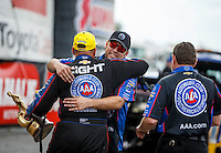 Mar 20, 2016; Gainesville, FL, USA; NHRA funny car driver Robert Hight celebrates with crew members after winning the Gatornationals at Auto Plus Raceway at Gainesville. Mandatory Credit: Mark J. Rebilas-USA TODAY Sports