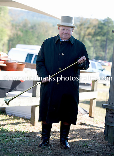 """Bugler George """"Bucky"""" Sallee keeps warm before calling the horses to the post at Callaway."""