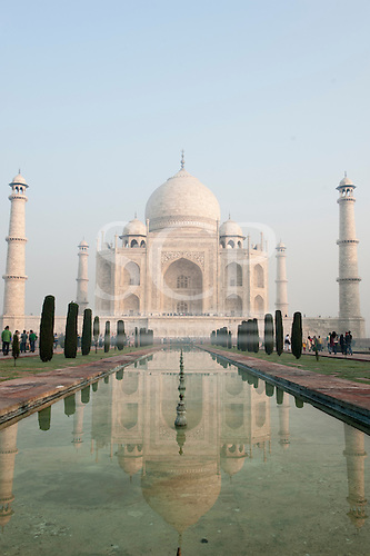 Agra, Uttar Pradesh, India. The Taj Mahal seen from the end of the al Hawd al-Kawthar tank, with its reflection, in the early morning light.