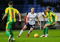 Bolton Wanderers' Pawel Olkowski competing with West Bromwich Albion's Jay Rodriguez<br /> <br /> Photographer Andrew Kearns/CameraSport<br /> <br /> The EFL Sky Bet Championship - Bolton Wanderers v West Bromwich Albion - Monday 21st January 2019 - University of Bolton Stadium - Bolton<br /> <br /> World Copyright © 2019 CameraSport. All rights reserved. 43 Linden Ave. Countesthorpe. Leicester. England. LE8 5PG - Tel: +44 (0) 116 277 4147 - admin@camerasport.com - www.camerasport.com