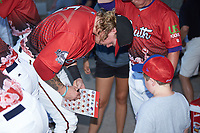 Tucker Neuhaus (5) of the Carolina Mudcats signs an autograph prior to the start of the 2018 Carolina League All-Star Classic at Five County Stadium on June 19, 2018 in Zebulon, North Carolina. The South All-Stars defeated the North All-Stars 7-6.  (Brian Westerholt/Four Seam Images)
