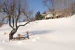Craig home in winter with snow and hayrake.