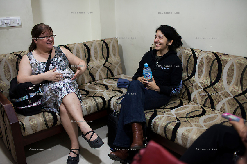 Barbara (left), who has just come from Canada to pick up her 1st baby from surrogacy, shares her success story with other surrogacy clients in a waiting room at the Akanksha IVF and surrogacy center, in Anand, Gujarat, India on 10th December 2012. Surrogacy clients come from all over the world to see Dr. Nayana Patel in hope to be able to have their own biological children through the hire of a surrogate to carry their babies. While 15% of couples are infertile globally, only 6% of infertility cases require surrogacy as a last option. Photo by Suzanne Lee / Marie-Claire France