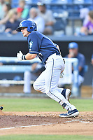 Asheville Tourists Will Golson (8) runs to first base during a game against the Lakewood BlueClaws at McCormick Field on August 3, 2019 in Asheville, North Carolina. The BlueClaws defeated the Tourists 10-6. (Tony Farlow/Four Seam Images)