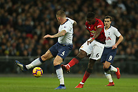 Paul Pogba of Manchester United and Toby Alderweireld and Harry Winks of Tottenham Hotspur during Tottenham Hotspur vs Manchester United, Premier League Football at Wembley Stadium on 13th January 2019