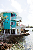 EXUMA, Bahamas. View of houses along the shore on Staniel Cay.
