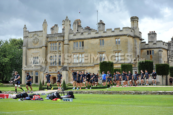 The Bath squad walk onto the field. Bath Rugby pre-season training session on August 18, 2014 at Farleigh House in Bath, England. Photo by: Patrick Khachfe/Onside Images