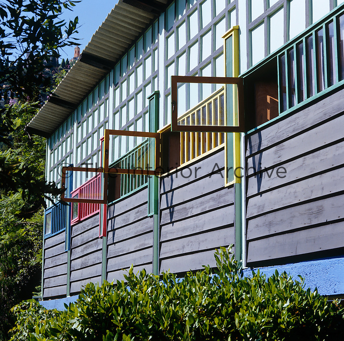 The small uniform windows which line the walls of the cabins are painted in primary colours