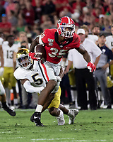 ATHENS, GA - SEPTEMBER 21: Brian Herrien #35 of the Georgia Bulldogs is tackled by Troy Pride Jr. #5 of the Notre Dame Fighting Irish during a game between Notre Dame Fighting Irish and University of Georgia Bulldogs at Sanford Stadium on September 21, 2019 in Athens, Georgia.