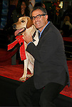 "WESTWOOD, CA. - December 11: Director David Frankel and Marley the Dog arrive at the Los Angeles premiere of ""Marley & Me"" at  Mann's Village Theater on December 11, 2008 in Los Angeles, California."