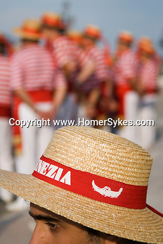 Venice Italy 2009. Tourist wearing traditional Gondoliers straw hat.