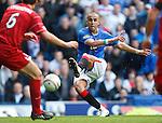 Madjid Bougherra blasts the ball towards goal