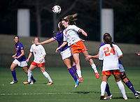 Morgan Brian (6) of Virginia goes up for a header with Katelyn Reeve (12) of Clemson at Klockner Stadium in Charlottesville, VA.  Virginia defeated Clemson, 3-0.