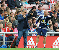 Dick Advocaat manager of Sunderland issues instructions to his players during the Barclays Premier League match between Sunderland and Swansea City played at Stadium of Light, Sunderland