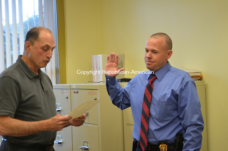 DATELINE, CT-17 September 2013- 091713AG01- Thomaston First Selectman Ed Mone swore in Jeffrey Madden as detective sergeant on Tuesday. The promotion marks the end of a series of hires and shifts in the department since former chief Eugene F. Torrence, Jr. retired in 2012.  Alexa Gorman Republican-American