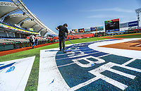 A man performs painting work of the Saribe Series logo on the Charros Stadium in Jalisco before the start of the Caribbean Baseball Series activities with the competition between teams from Mexico, Cuba, Venezuela, Puerto Rico and Dominican Republic,<br />