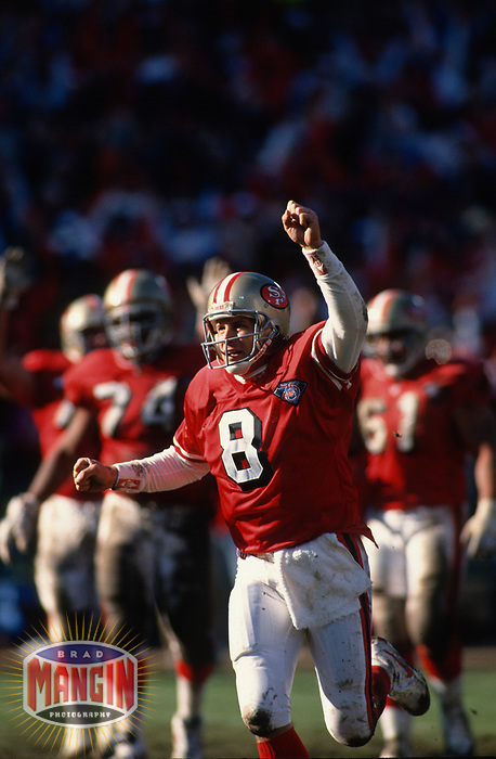 SAN FRANCISCO, CA:  Quarterback Steve Young of the San Francisco 49ers celebrates during the NFC Championship game against the Dallas Cowboys at Candlestick Park in San Francisco, California on January 15, 1995. (Photo by Brad Mangin)