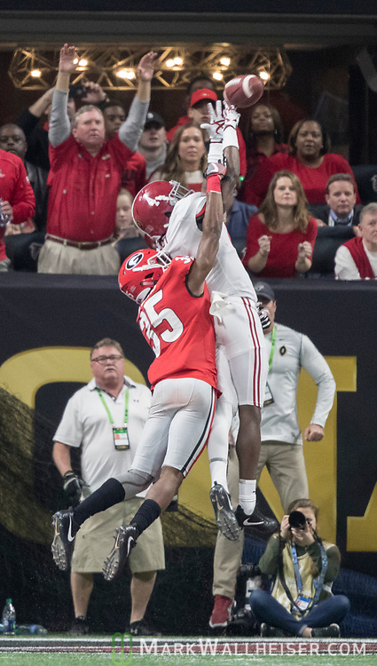 Georgia Bulldogs defensive back Aaron Davis (35) breaks up a pass in the end zone intended for Alabama Crimson Tide wide receiver Jerry Jeudy (4) in the fourth quarter of the NCAA College Football Playoff National Championship at Mercedes-Benz Stadium on January 8, 2018 in Atlanta. Photo by Mark Wallheiser/UPI