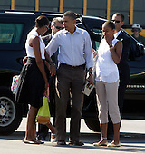 United States President Barack Obama, flanked by his wife Michelle and daughter Malia right, and Sasha, partially hidden, get ready to board Marine One helicopter on Martha's Vineyard, Massachusetts Sunday, August 29, 2010. The First Family completed their 10-day vacation on Martha's Vineyard and were flying to Cape Cod to board Air Force One  for New Orleans where the President is giving a speech today on the fifth year anniversary of Hurricane Katrina. .Credit: Vincent DeWitt - Pool via CNP