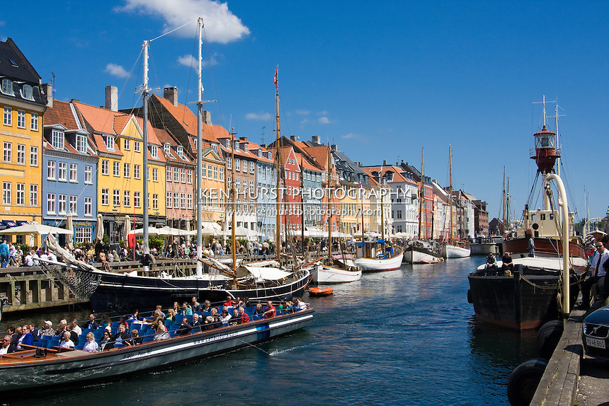 Tour boat on Nyhavn or New Harbor canal in Copenhagen, Denmark.