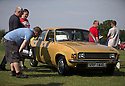 26/07/14 <br /> <br /> Princess Diana's Mini Metro was the star of the show at the first ever Festival of the Unexceptional.<br /> <br /> The car show held near Silverstone celebrated the best examples of the most ordinary cars of late 1960s to mid-1980s Britain.<br /> <br /> Organisers, Hagerty Insurance, said: &quot;Let&rsquo;s celebrate, preserve and enjoy these threatened and endangered pieces of our beige, brown and plaid automotive heritage.<br /> <br />  &quot;There are twice as many Ferraris on the road in the UK than Austin Allegros! We&rsquo;ve brought together the 50 best examples of a wide range of models - an award of dubious value will go to the overall winner.&quot;<br /> <br /> Princess Diana's red 1980 Mini Metro L was photographed many times while she was dating Prince Charles and was affectionately known as the 'courting car'. It has had three owners since it left the Royal fleet, and has clocked-up a very modest 30,000 miles. <br /> <br /> <br /> All Rights Reserved - F Stop Press.  www.fstoppress.com. Tel: +44 (0)1335 300098