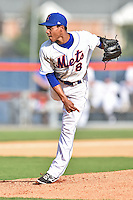 Kingsport Mets starting pitcher Persio Reyes #8 delivers a pitch during a game against the Johnson City Cardinals at Hunter Wright Stadium August 24, 2014 in Kingsport, Tennessee. The Mets defeated the Cardinals 9-1. (Tony Farlow/Four Seam Images)