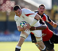 Photo: Richard Lane/Richard Lane Photography. .IRB Junior World Championship. England U20 v Canada U20. 10/06/2008. England's Ben Thomas is tackled by Canada's Jordan Wilson-Ross.