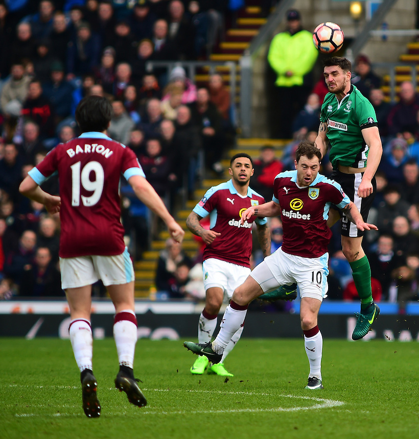 Lincoln City's Luke Waterfall vies for possession with Burnley's Ashley Barnes<br /> <br /> Photographer Andrew Vaughan/CameraSport<br /> <br /> Emirates FA Cup Fifth Round - Burnley v Lincoln City - Saturday 18th February 2017 - Turf Moor - Burnley <br />  <br /> World Copyright &copy; 2017 CameraSport. All rights reserved. 43 Linden Ave. Countesthorpe. Leicester. England. LE8 5PG - Tel: +44 (0) 116 277 4147 - admin@camerasport.com - www.camerasport.com