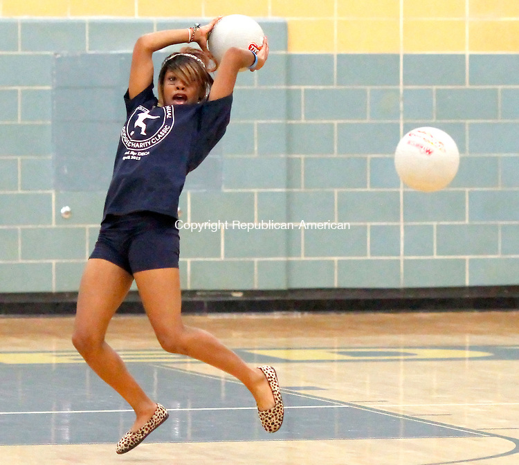 "Waterbury, CT-20 April 2012-042012CM08- Imani Braxton moves out of the way of incoming playground balls during the 3rd annual charity dodgeball tournament Friday night at Kennedy High School in Waterbury.  The fundraiser is organized by the school's DECA club chapter with proceeds going to the favored charity of the winning team.    ""It's nice to have the kids at the school on a Friday night having fun in a safe environment and raising money for charity."" said School principal Michael Yamin.    Christopher Massa Republican-American"