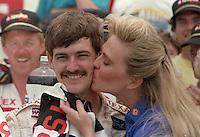 Davey Allison 1st place winner victory lane beauty queen kiss Pepsi 400 at Daytona International Speedway in Daytona beach, FL on July 1, 1989. (Photo by Brian Cleary/www.bcpix.com)