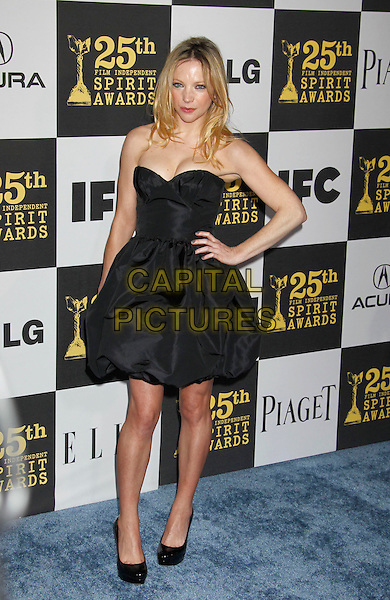 NATALIE DORMER.25th Annual Film Independent Spirit Awards - Arrivals held at the Nokia Event Deck at L.A. Live, Los Angeles, California, USA, 5th March 2010..indie full length dress black strapless hand on hip shoes .CAP/ADM/MJ.©Michael Jade/AdMedia/Capital Pictures.
