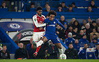 Willian of Chelsea & Ainsley Maitland-Niles of Arsenal during the Carabao Cup semi final 1st leg match between Chelsea and Arsenal at Stamford Bridge, London, England on 10 January 2018. Photo by Andy Rowland.