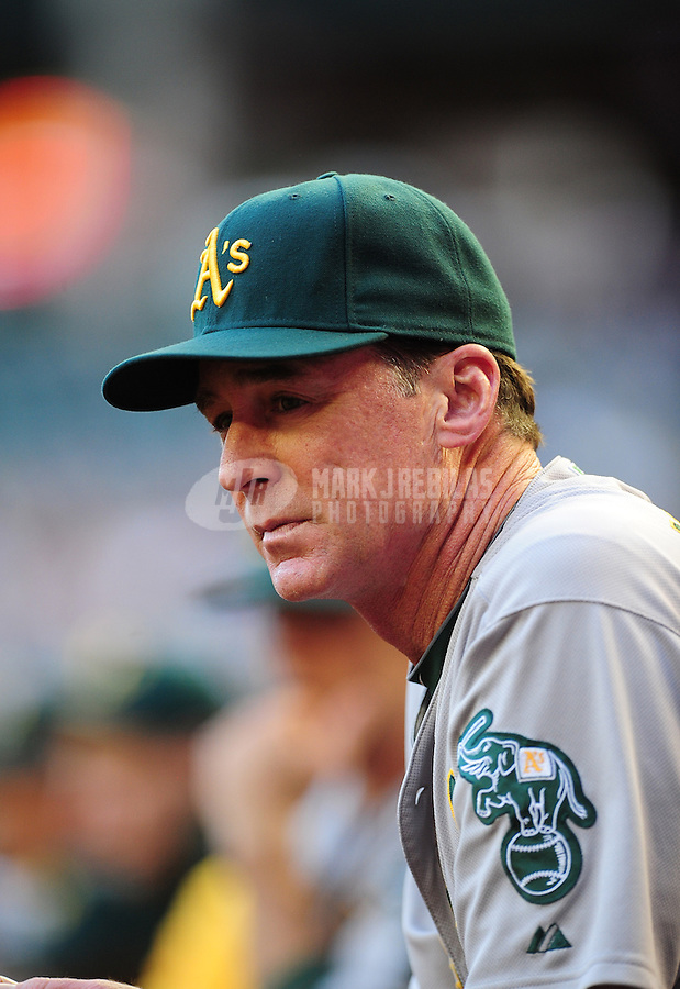 Jun. 8, 2012; Phoenix, AZ, USA; Oakland Athletics manager Bob Melvin in the dugout in the first inning against the Arizona Diamondbacks at Chase Field.  Mandatory Credit: Mark J. Rebilas-
