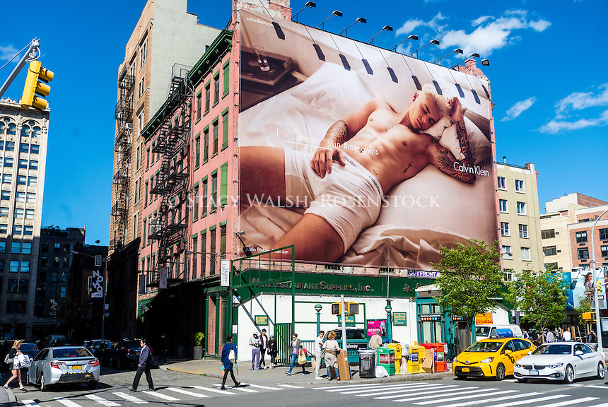 New York, NY May 8th 2016 Calvin Klein billboard advertisement, in the NoHo neighborhood of Manhattan, features pop star Justin Bieber toughing himself. © Stacy Walsh Rosenstock.