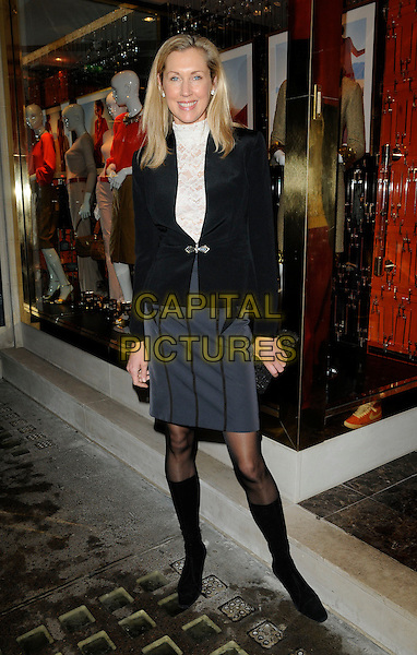 CATRINA SKEPPER .At the Tory Burch Flagship Store Launch, New Bond Street, London, England, UK January 25th 2011..full length black jacket white lace high polo neck top grey gray skirt tights knee high boots .CAP/CAN.©Can Nguyen/Capital Pictures.